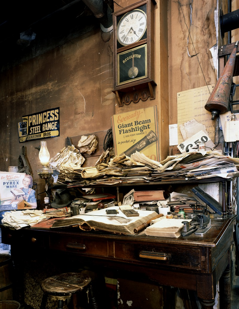 Cluttered_desk_at_the_historic_Harrison_Brothers_Hardware_in_Huntsville,_Alabama,_whose_shelves,_resembling_an_old-time_general_store,_are_equally_crammed_with_an_assortment_of_vintage_as_well_as_LCCN2011634695.tif.jpg